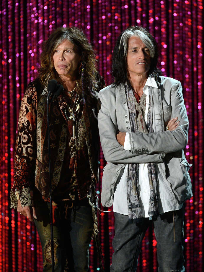 Musicians Steven Tyler and Joe Perry of Aerosmith speak onstage during the 2012 MTV Movie Awards at Gibson Amphitheatre on June 3, 2012 in Universal City, California. Photo: Kevork Djansezian, Getty Images / 2012 WireImage