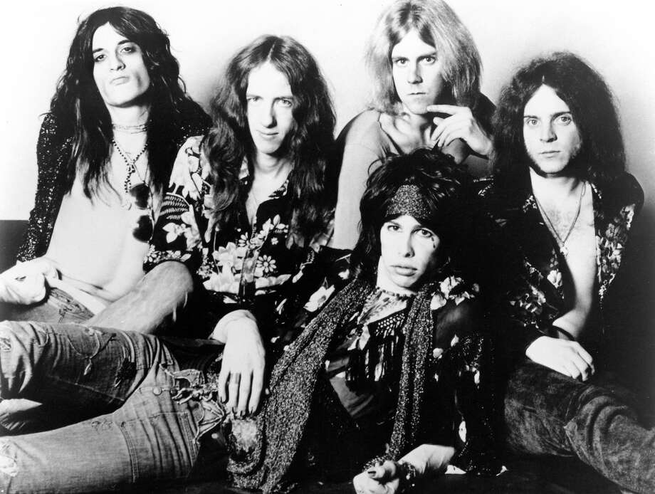 Aerosmith's Joe Perry, Brad Whitford, Steven Tyler (front), Tom Hamilton (back), Joey Kramer - posed, studio, group shot in 1974. Photo: Gems, Getty Images / Redferns