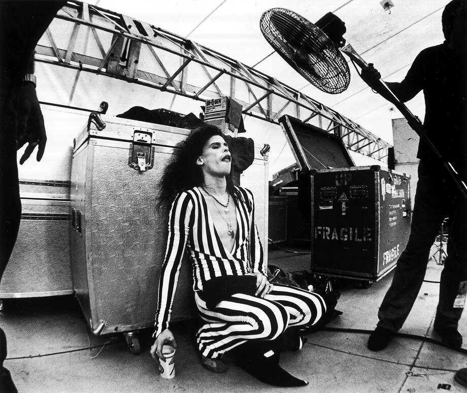 Lead singer Steven Tyler cools down with the aid of a large fan held by a roadie live at Washington RFK stadium in 1976. Photo: Fin Costello, Getty Images / Redferns