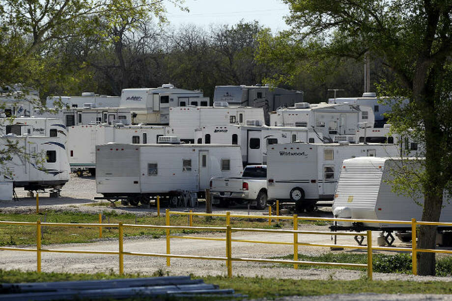 Trailers are packed into a gravel space at Lonesome Creek RV Resort near Kenedy, Texas.