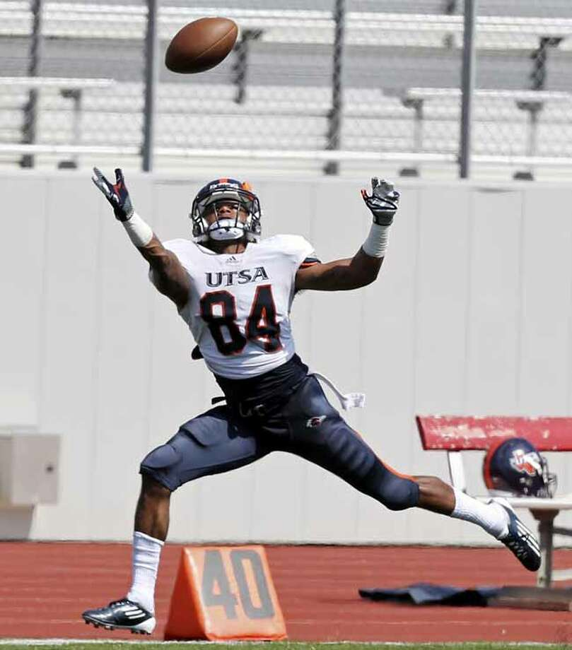 UTSA's Brandon Freeman goes up for a pass during scrimmage Saturday March 23, 2013 at D.W. Rutledge Stadium. Photo: Edward A. Ornelas, San Antonio Express-News / © 2013 San Antonio Express-News