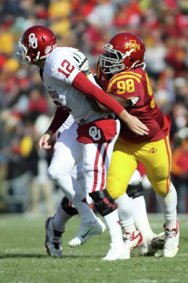 Iowa State defensive lineman Henry Simon looks to make a play against Oklahoma on Nov. 3, 2012. Photo: ISU Athletics Communications