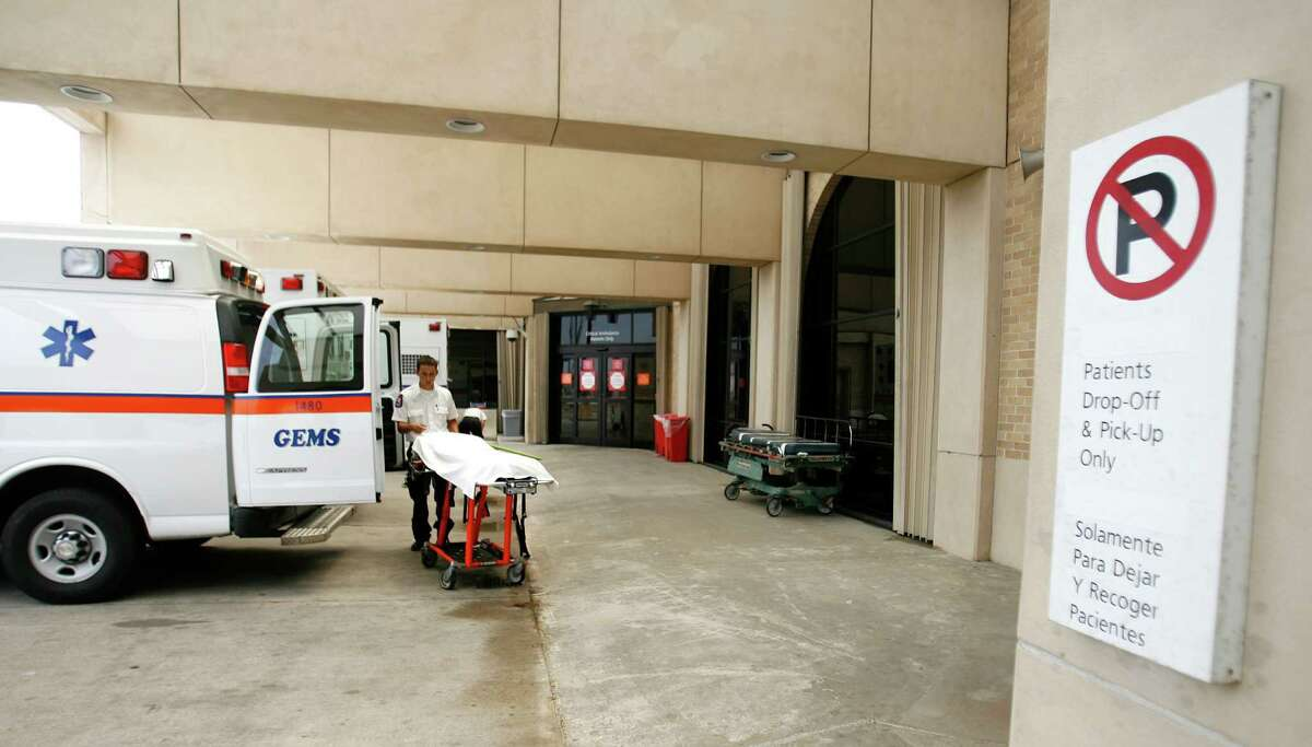 An EMT with Galveston EMS, prepares his ambulance in the bay area of the emergency room at UTMB in Galveston.