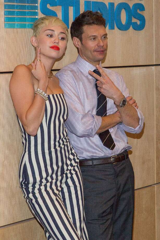 Miley Cyrus and Ryan Seacrest attend the Ryan Seacrest Foundation's West Coast debut of a new multi-media broadcast center, Seacrest Studios, at CHOC Children's with live broadcast on KIIS FM at CHOC Children's Hospital on March 22, 2013 in Orange, California. Photo: Paul A. Hebert, Getty Images / 2013 Paul A. Hebert
