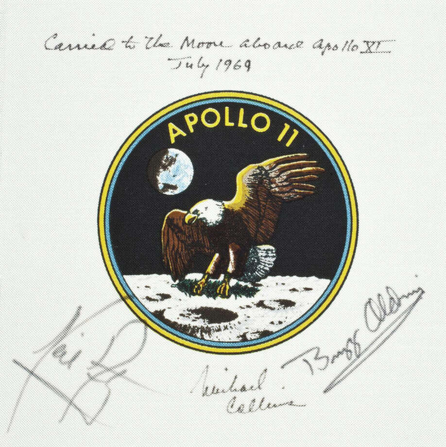 Flown Apollo 11 Beta cloth crew emblem, 3½ inches in diameter, printed on white Beta cloth 6 inches square. SIGNED by the Apollo 11 crew: NEIL ARMSTRONG, MICHAEL COLLINS, and BUZZ ALDRIN.