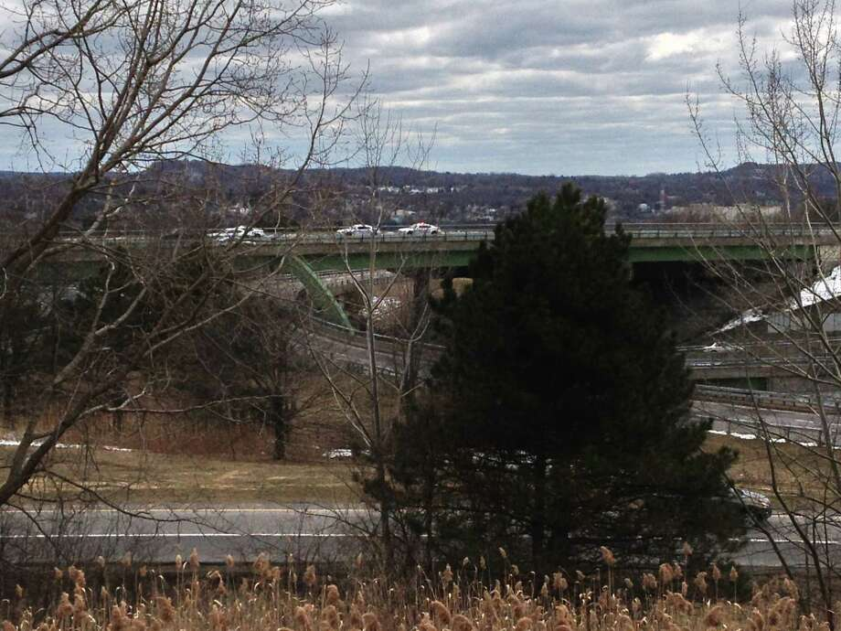 Police are massed on the bridge that carries Route 9 over Interstate 90 in Albany as they investigate a report of a man who texted a photograph of himself near the edge of the bridge. (Jordan Carleo-Evangelist)