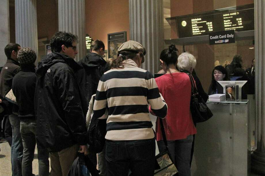 In this Tuesday, March 19, 2013 photo visitors to the Metropolitan Museum of Art in New York wait in line to buy admission tickets. (AP Photo/Mary Altaffer) Photo: Mary Altaffer