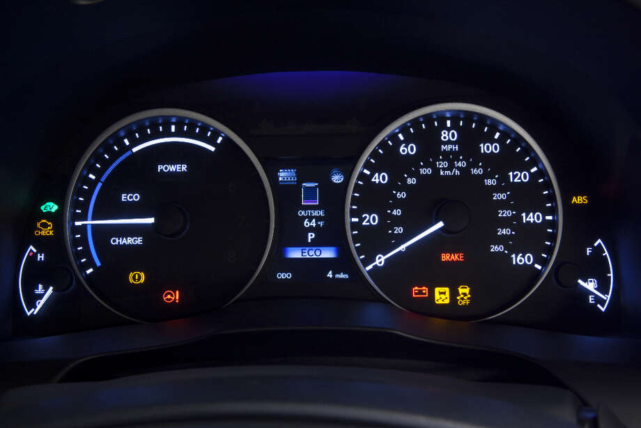 The big dial on the left can switch faces from a hybrid system monitor to a straight-out tachometer when you put the car into Sport mode.