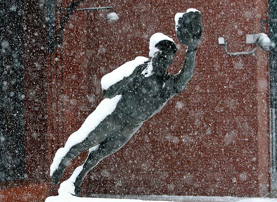 The blizzard of Oz: Snow covers the statue of Hall of Fame shortstop Ozzie Smith outside Busch Stadium in  St. Louis. Photo: J.B. Forbes, Associated Press