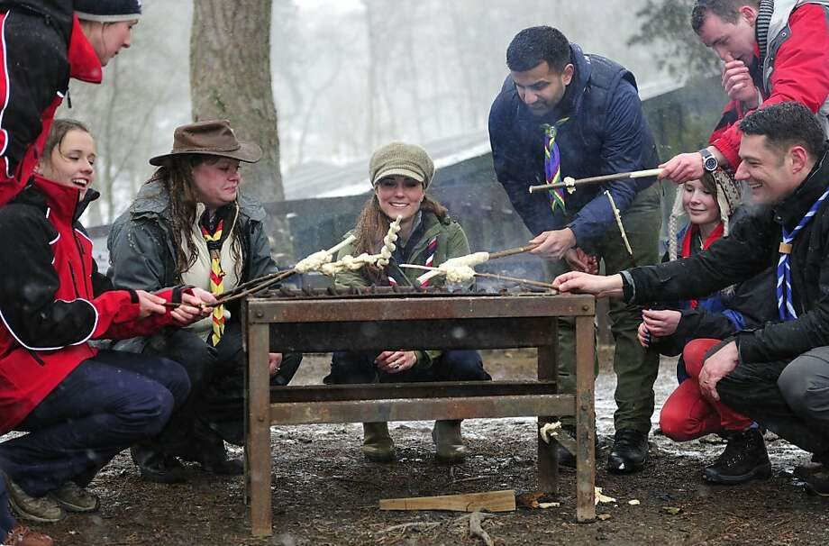 Expectant mothers are known for their questionable dietary choices - i.e. pickles with ice cream - and the Duchess of Cambridge is no exception. Here Kate enjoys barbecued dough on a stick at Scout volunteer training day in Newby Bridge, England. Yum! Photo: WPA Pool, Getty Images
