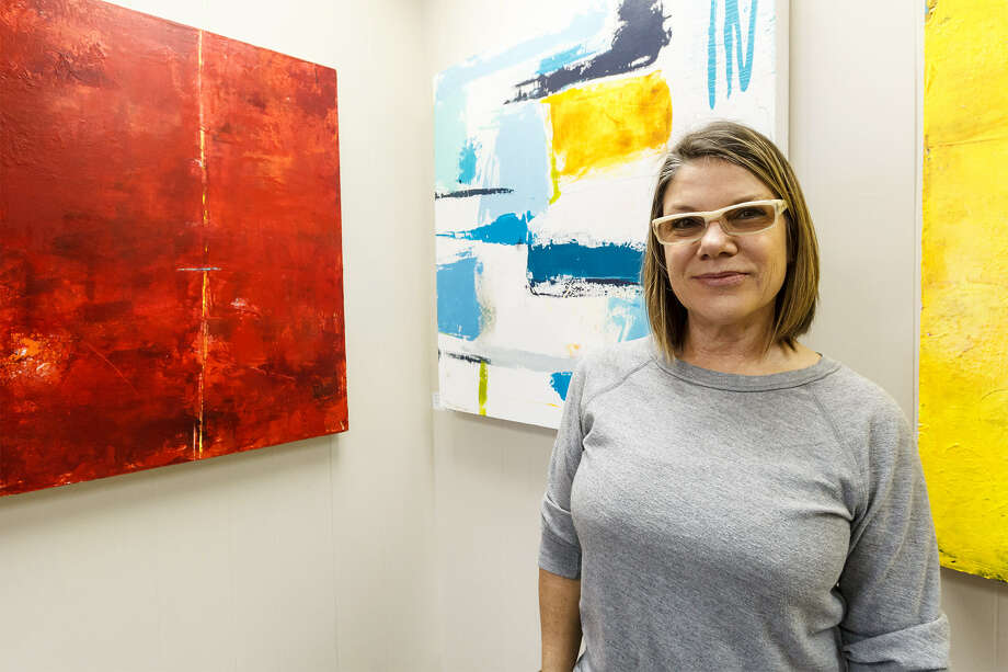 Mercury Project owner Antonia Richardson with some of her pieces on display at the art gallery located at 538 Roosevelt Ave. Photo: Marvin Pfeiffer/ Southside Reporter