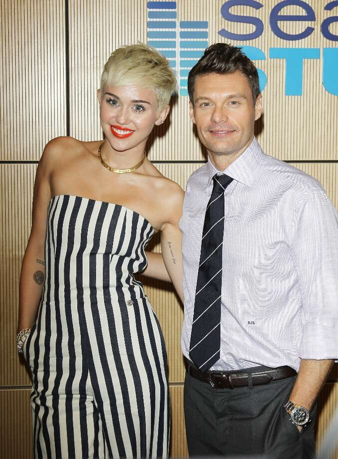 Miley Cyrus (L) and Ryan Seacrest attend The Ryan Seacrest Foundation West Coast debut of new multi-media broadcast center Seacrest Studios held at CHOC Children's Hospital on March 22, 2013 in Orange, California. Photo: Michael Tran, FilmMagic / 2013 Michael Tran
