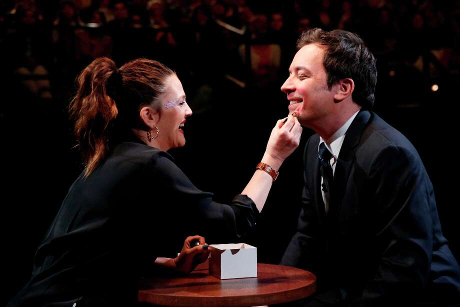 Drew Barrymore makes-up Late Night host Jimmy Fallon during a skit on March 21, 2013. Photo: NBC, NBCU Photo Bank Via Getty Images / 2013 NBCUniversal Media, LLC