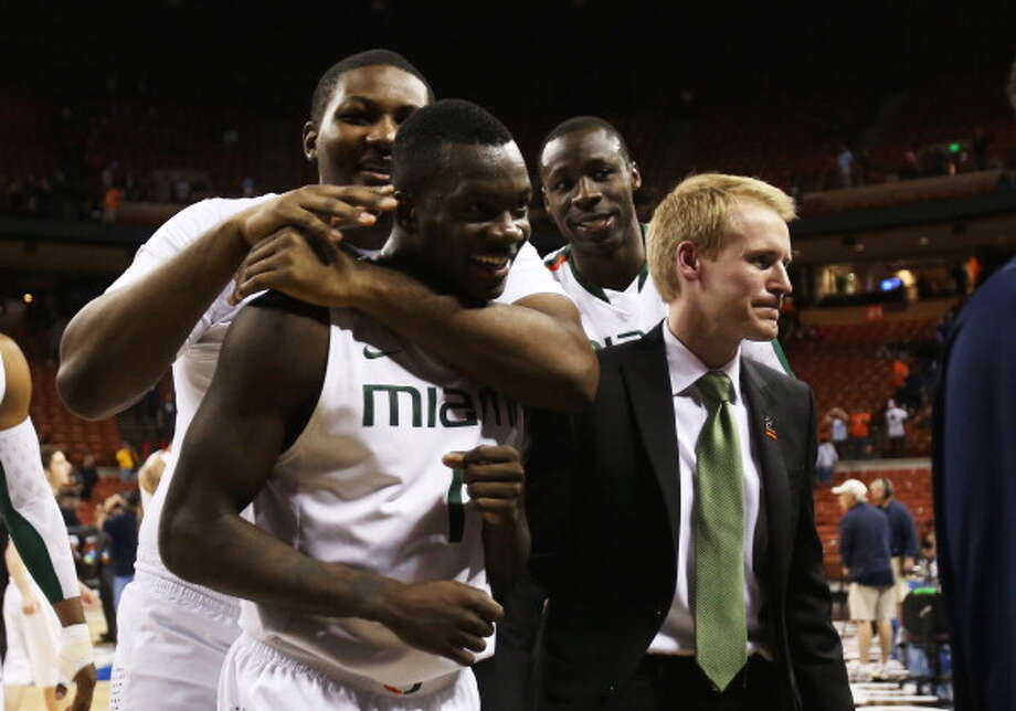 AUSTIN, TX - MARCH 24:  Durand Scott #1 of the Miami Hurricanes celebrates with teammates after their 63 to 59 win over the Illinois Fighting Illini during the third round of the 2013 NCAA Men's Basketball Tournament at The Frank Erwin Center on March 24, 2013 in Austin, Texas. Photo: Ronald Martinez, Getty Images / 2013 Getty Images