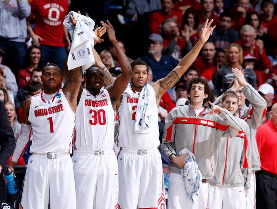 DAYTON, OH - MARCH 24: Deshaun Thomas #1, Evan Ravenel #30 and Amir Williams #23 of the Ohio State Buckeyes celebrate with teammates on the bench after a basket in the second half against the Iowa State Cyclones during the third round of the 2013 NCAA Men's Basketball Tournament at UD Arena on March 24, 2013 in Dayton, Ohio. Photo: Joe Robbins, Getty Images / 2013 Getty Images