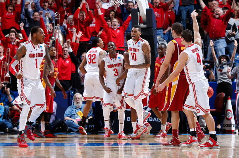 DAYTON, OH - MARCH 24: Deshaun Thomas #1, Shannon Scott #3 and LaQuinton Ross #10 of the Ohio State Buckeyes celebrate after Aaron Craft #4 makes a three point basket late in the second half to take the lead against the Iowa State Cyclones during the third round of the 2013 NCAA Men's Basketball Tournament at UD Arena on March 24, 2013 in Dayton, Ohio. Photo: Joe Robbins, Getty Images / 2013 Getty Images
