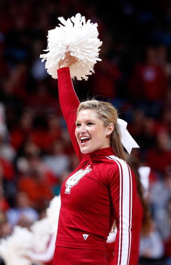 DAYTON, OH - MARCH 24: An Indiana Hoosiers cheerleader performs on the court in the second half against the Temple Owls during the third round of the 2013 NCAA Men's Basketball Tournament at UD Arena on March 24, 2013 in Dayton, Ohio. Photo: Joe Robbins, Getty Images / 2013 Getty Images