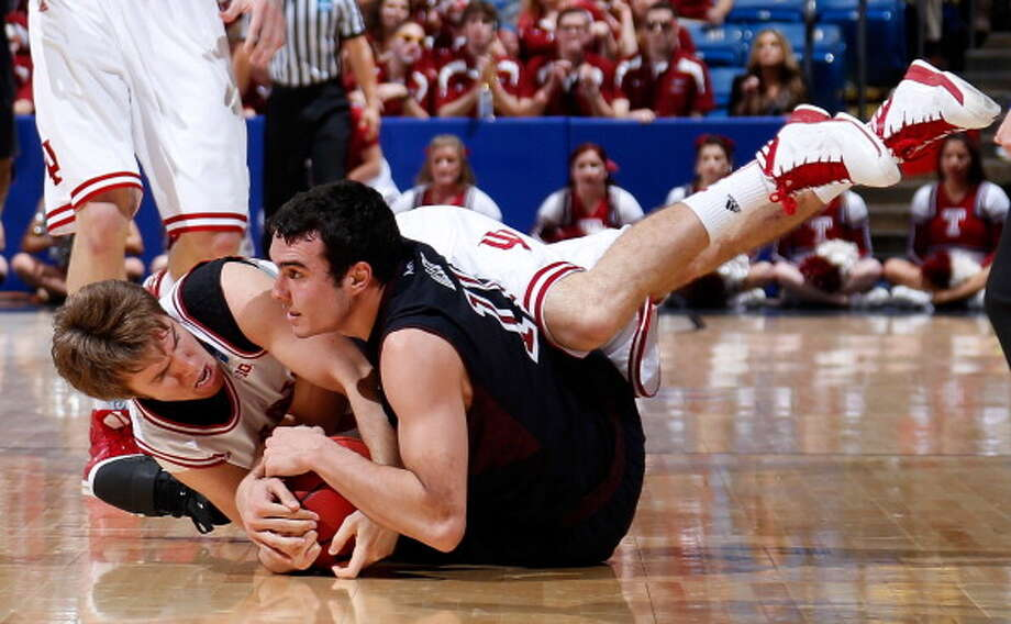 DAYTON, OH - MARCH 24: T.J. DiLeo #11 of the Temple Owls and Jordan Hulls #1 of the Indiana Hoosiers fight for a loose ball in the second half during the third round of the 2013 NCAA Men's Basketball Tournament at UD Arena on March 24, 2013 in Dayton, Ohio. Photo: Joe Robbins, Getty Images / 2013 Getty Images
