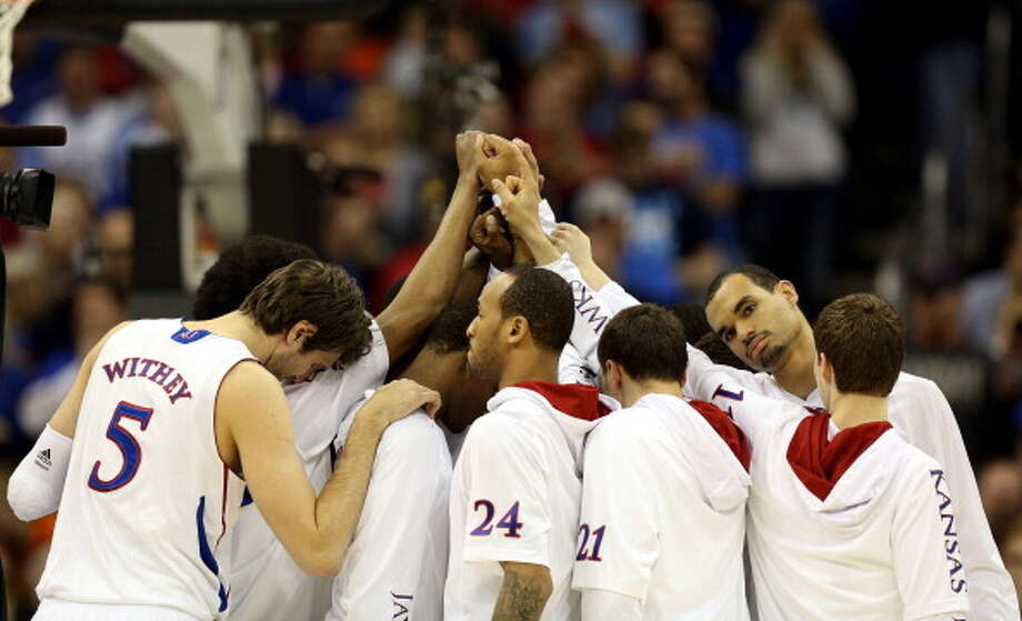 KANSAS CITY, MO - MARCH 24:  The Kansas Jayhawks huddle prior to playing against the North Carolina Tar Heels during the third round of the 2013 NCAA Men's Basketball Tournament at Sprint Center on March 24, 2013 in Kansas City, Missouri. Photo: Ed Zurga, Getty Images / 2013 Getty Images