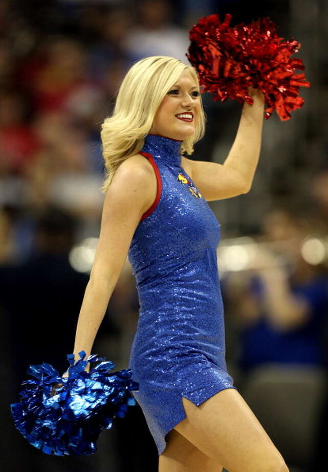 KANSAS CITY, MO - MARCH 24:  A cheerleader for the Kansas Jayhawks performs in the first half against the North Carolina Tar Heels during the third round of the 2013 NCAA Men's Basketball Tournament at Sprint Center on March 24, 2013 in Kansas City, Missouri. Photo: Ed Zurga, Getty Images / 2013 Getty Images