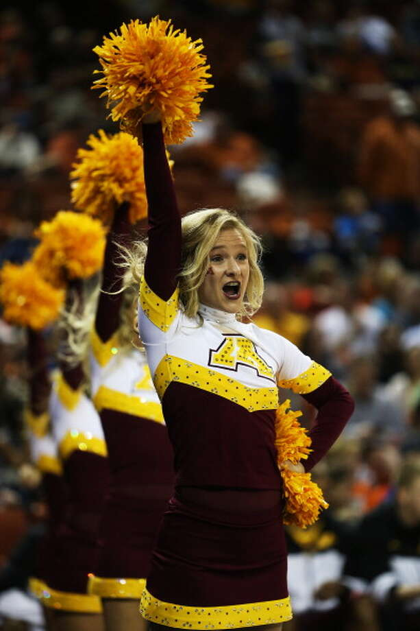 AUSTIN, TX - MARCH 24:  A Minnesota Golden Gophers cheerleader performs in the first half against the Florida Gators during the third round of the 2013 NCAA Men's Basketball Tournament at The Frank Erwin Center on March 24, 2013 in Austin, Texas. Photo: Ronald Martinez, Getty Images / 2013 Getty Images