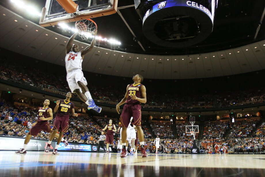 AUSTIN, TX - MARCH 24:  Casey Prather #24 of the Florida Gators dunks on the Minnesota Golden Gophers in the first half during the third round of the 2013 NCAA Men's Basketball Tournament at The Frank Erwin Center on March 24, 2013 in Austin, Texas. Photo: Ronald Martinez, Getty Images / 2013 Getty Images