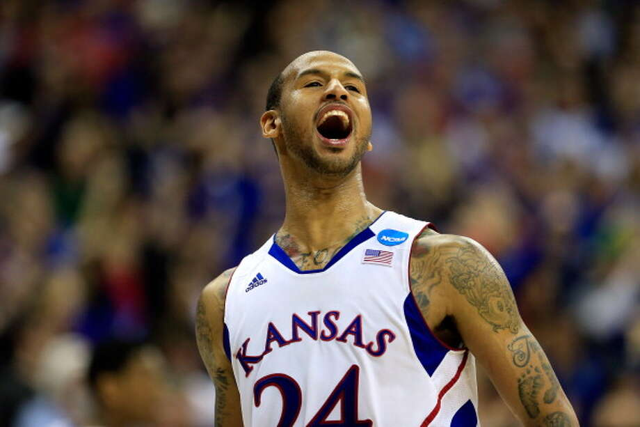 KANSAS CITY, MO - MARCH 24:  Travis Releford #24 of the Kansas Jayhawks celebrates against the North Carolina Tar Heels during the third round of the 2013 NCAA Men's Basketball Tournament at Sprint Center on March 24, 2013 in Kansas City, Missouri. Photo: Jamie Squire, Getty Images / 2013 Getty Images