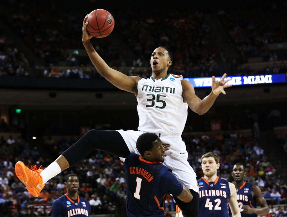 AUSTIN, TX - MARCH 24:  Kenny Kadji #35 of the Miami Hurricanes goes up against D.J. Richardson #1 of the Illinois Fighting Illini in the first half during the third round of the 2013 NCAA Men's Basketball Tournament at The Frank Erwin Center on March 24, 2013 in Austin, Texas. Photo: Stephen Dunn, Getty Images / 2013 Getty Images