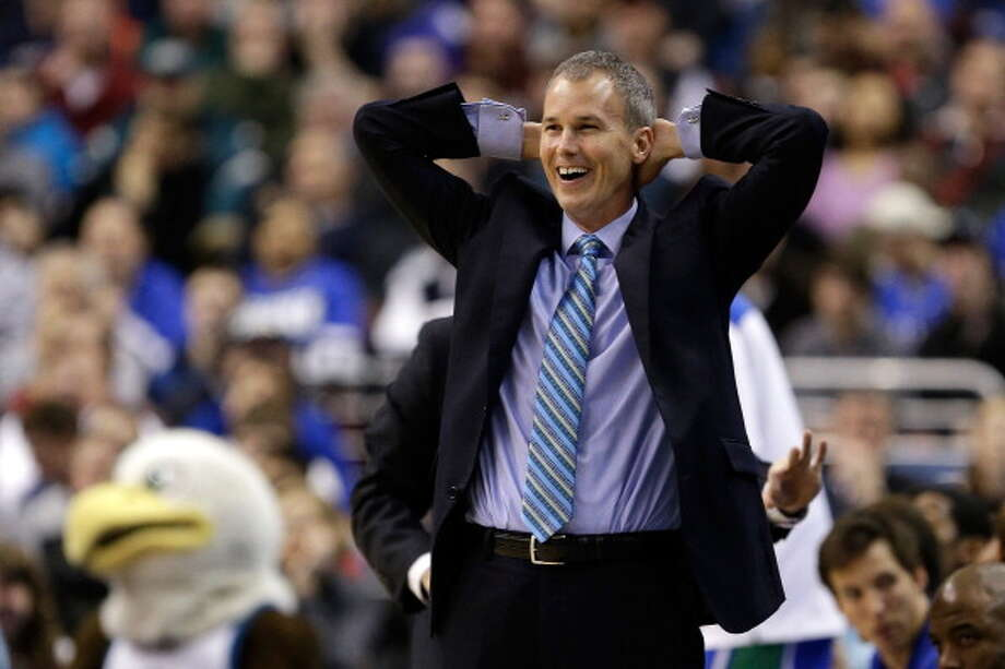 PHILADELPHIA, PA - MARCH 24:  Head coach Andy Enfield of the Florida Gulf Coast Eagles smiles in the second half while taking on the San Diego State Aztecs during the third round of the 2013 NCAA Men's Basketball Tournament at Wells Fargo Center on March 24, 2013 in Philadelphia, Pennsylvania. Photo: Rob Carr, Getty Images / 2013 Getty Images