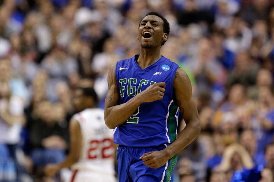 PHILADELPHIA, PA - MARCH 24:  Bernard Thompson #2 of the Florida Gulf Coast Eagles reacts in the second half while taking on the San Diego State Aztecs during the third round of the 2013 NCAA Men's Basketball Tournament at Wells Fargo Center on March 24, 2013 in Philadelphia, Pennsylvania. Photo: Rob Carr, Getty Images / 2013 Getty Images