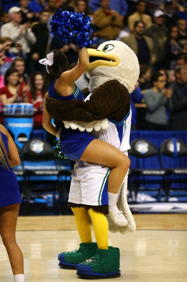 PHILADELPHIA, PA - MARCH 24:  The Florida Gulf Coast Eagles mascot picks up an Eagles cheerleader after the Eagles 81-71 victory against the San Diego State Aztecs during the third round of the 2013 NCAA Men's Basketball Tournament at Wells Fargo Center on March 24, 2013 in Philadelphia, Pennsylvania. Photo: Elsa, Getty Images / 2013 Getty Images