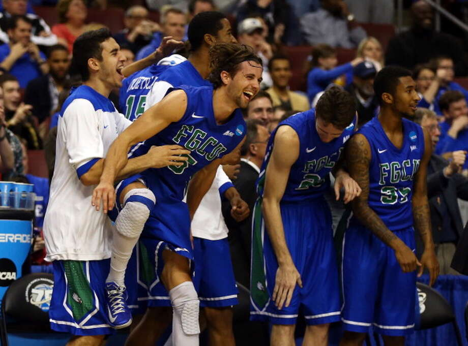 PHILADELPHIA, PA - MARCH 24:  Christophe Varidel #5 of the Florida Gulf Coast Eagles celebrates on the bench late in the second half while taking on the San Diego State Aztecs during the third round of the 2013 NCAA Men's Basketball Tournament at Wells Fargo Center on March 24, 2013 in Philadelphia, Pennsylvania. Photo: Elsa, Getty Images / 2013 Getty Images