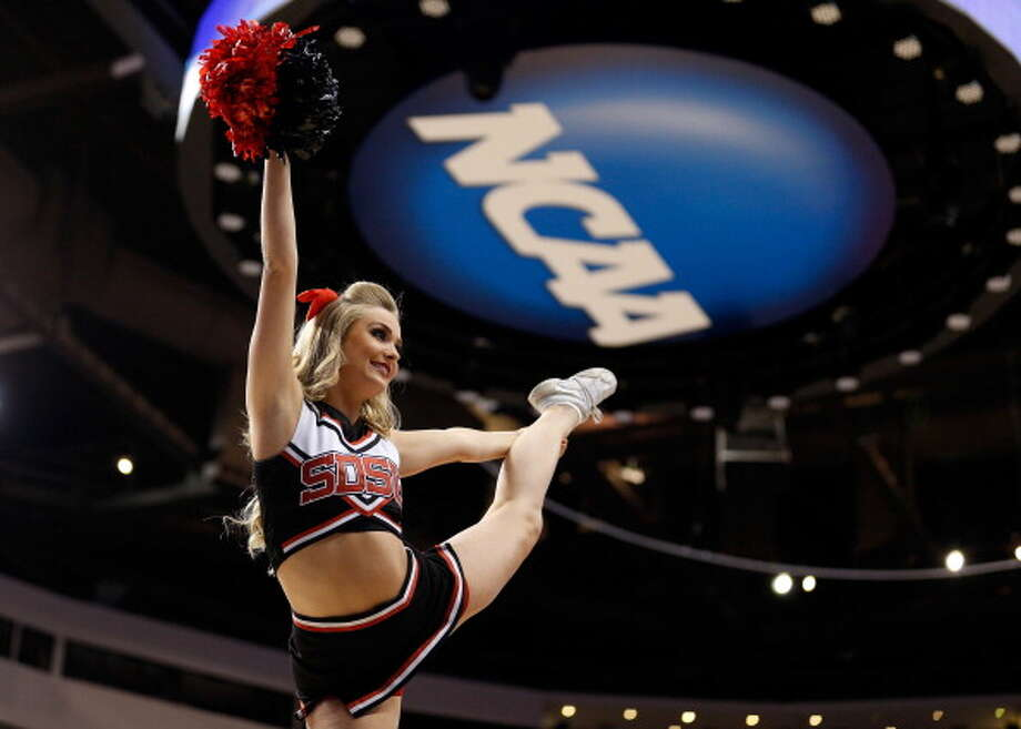 PHILADELPHIA, PA - MARCH 24:  A San Diego State Aztecs cheerleader performs in the second half while taking on the Florida Gulf Coast Eagles during the third round of the 2013 NCAA Men's Basketball Tournament at Wells Fargo Center on March 24, 2013 in Philadelphia, Pennsylvania. Photo: Rob Carr, Getty Images / 2013 Getty Images