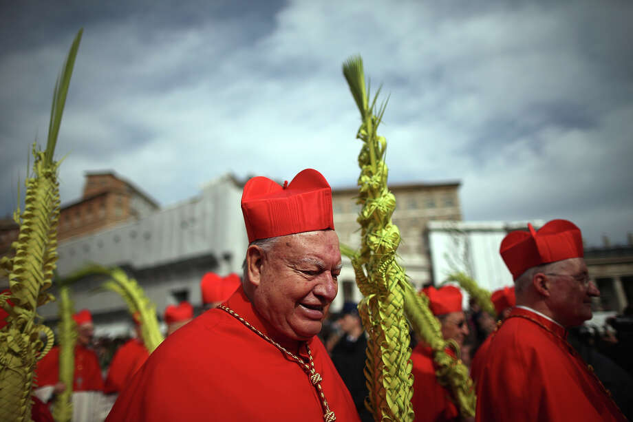 Cardinals process to the Obelisk as Pope Francis delivers his blessing to the palms and to the faithful gathered in St. Peter's Square during Palm Sunday Mass on March 24, 2013 in Vatican City, Vatican. Pope Francis lead his first mass of Holy Week as pontiff by celebrating Palm Sunday in front of thousands of faithful and clergy. The pope's first holy week will also incorporate him washing the feet of prisoners in a youth detention centre in Rome next Thursday, 28th March. Photo: Christopher Furlong, Getty Images / 2013 Getty Images