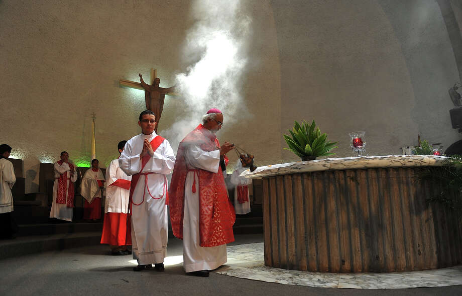 The Archbishop of Managua, Leopoldo Brenes (R), celebrates Palm Sunday mass at the Cathedral of Managua, on March 24, 2013. Palm Sunday marks the beginning of Holy Week, and commemorates Christ's triumphant entry into Jerusalem on the back of a donkey, welcomed by crowds waving palm branches, before his arrest, trial, crucifixion and resurrection. It is traditionally marked by a procession and special mass. Photo: HECTOR RETAMAL, AFP/Getty Images / 2013 AFP