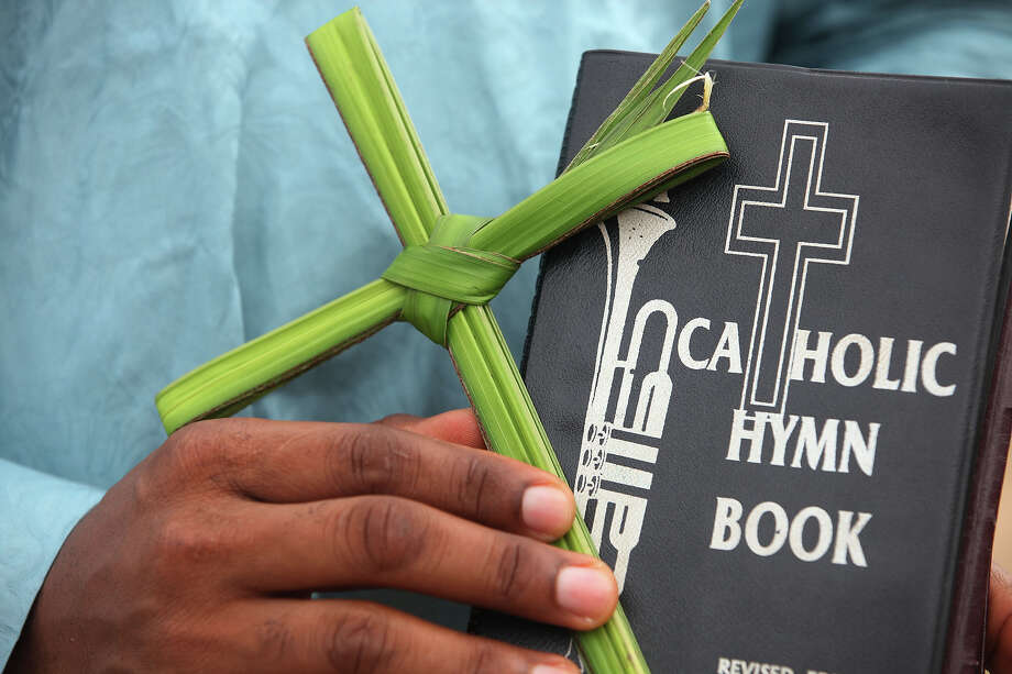 A man hold palm leaves in the shape of a cross during a Palm Sunday procession in Lagos, Nigeria, Sunday, March 24, 2013. Palm Sunday marks the sixth and last Sunday of the Christian Holy month of Lent and the beginning of Holy Week. Photo: Sunday Alamba, AP / AP