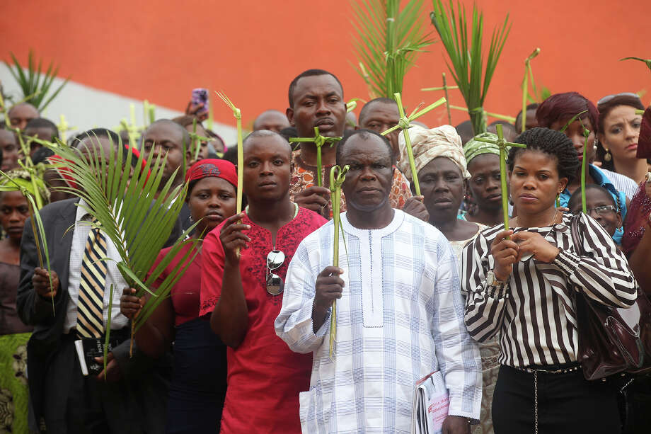 Catholics faithful  hold palm leaves  during a Palm Sunday procession in Lagos, Nigeria, Sunday, March 24, 2013. Palm Sunday marks the sixth and last Sunday of the Christian Holy month of Lent and the beginning of Holy Week. Photo: Sunday Alamba, ASSOCIATED PRESS / AP2013