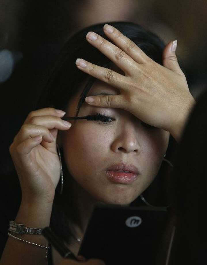 ustomer Janice Cheung from San Francisco applying mascara during a Trish McEvoy product demonstration.