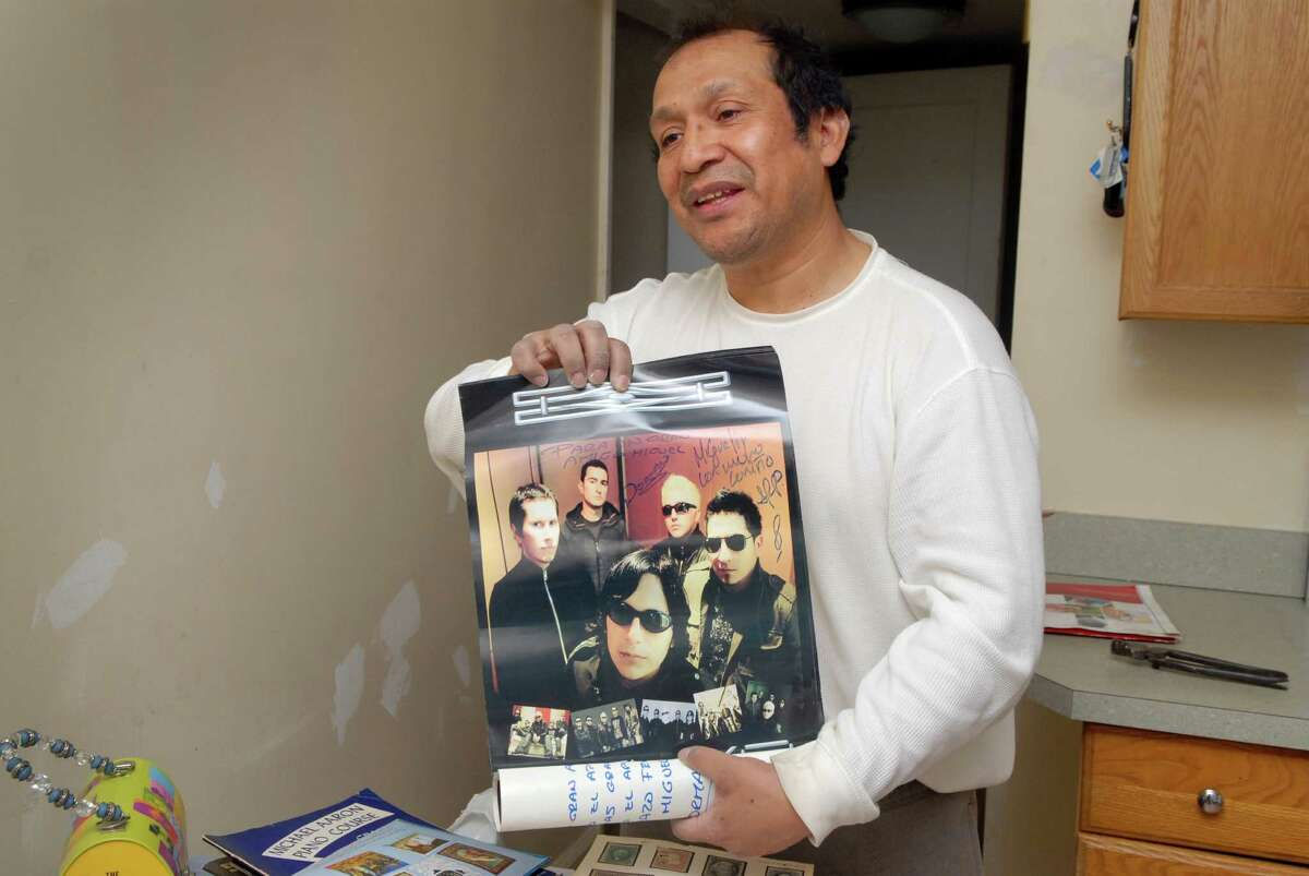Ecuadorian native Miguel Vanegas with some of his collection of records and autographs in his Stamford, Conn. home on Monday March 25, 2013.