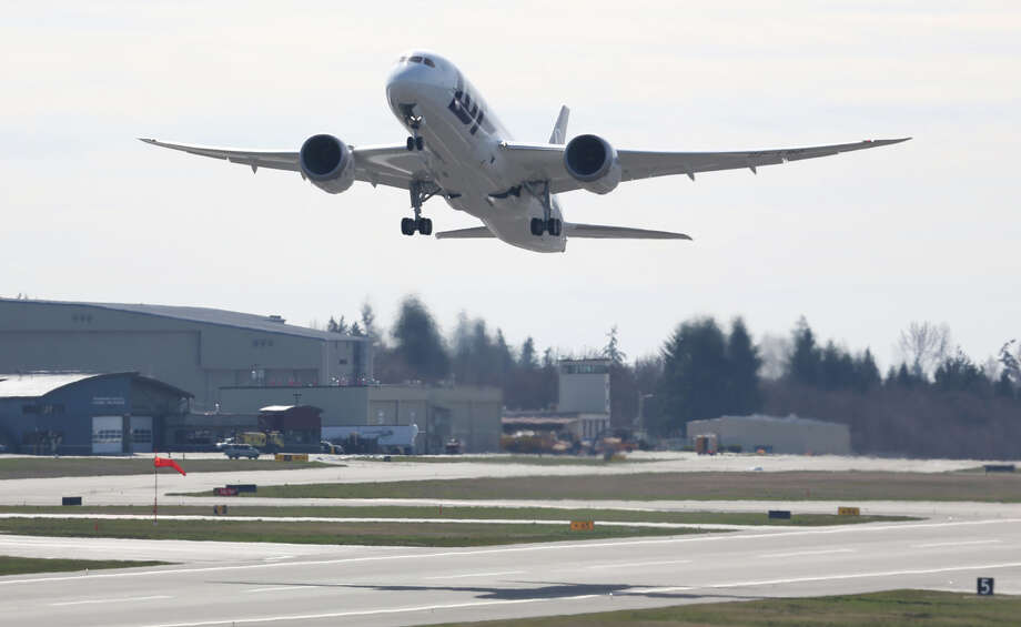 A Boeing 787 lifts off on Monday, March 25, 2013 at Paine Field in Everett. This was the first test flight of a 787 since the fleet was grounded because the danger of a fire with the lithium-Ion battery in the plane. Photo: JOSHUA TRUJILLO / SEATTLEPI.COM