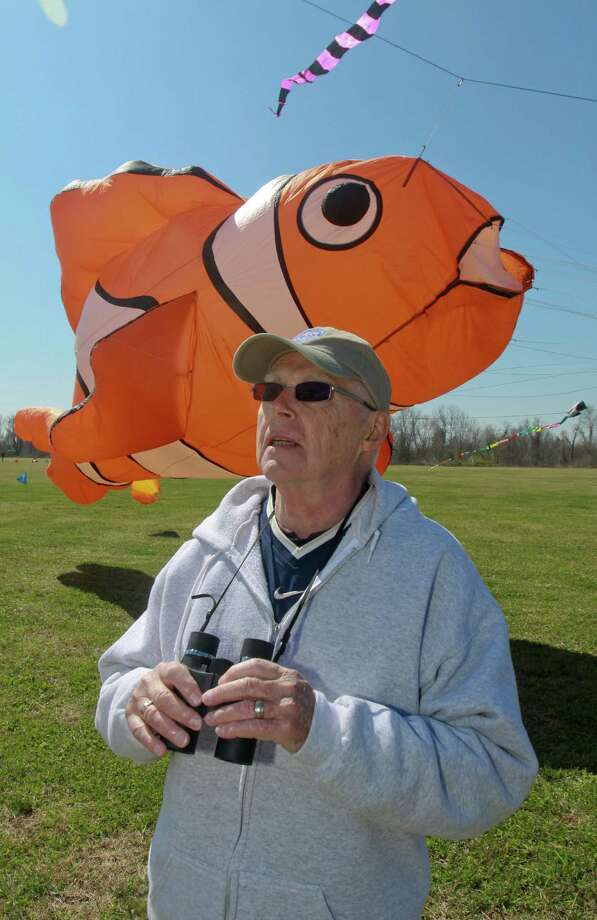 Bill Roy enjoys the Kite Festival in Sugar Land, as the clownfish kite owned by Rick Hawkins is brought into land. Photo: Gary Fountain, Freelance / Copyright 2013 Gary Fountain.