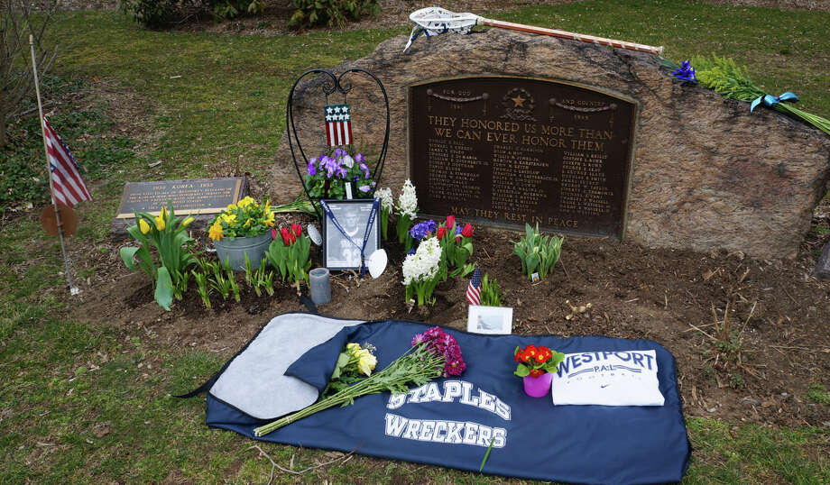 A informal collection of tributes has been placed on Veterans Green in memory of Marine Lance Cpl. Roger W. Muchnick Jr., a former Westport resident killed in a training accident last week.  WESTPORT NEWS, CT 3/25/13 Photo: Paul Schott / Westport News