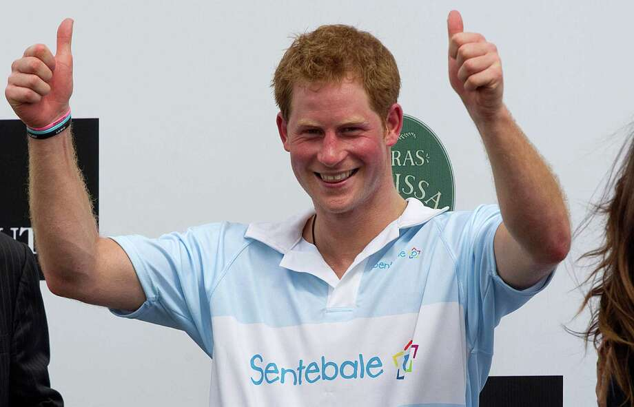 FILE - In this Sunday March 11, 2012 file photo Britain's Prince Harry gives a thumbs up during the award ceremony after playing a charity polo match in Campinas, Brazil. St. James's Palace say Monday March 25, 2013, Prince Harry is returning to the United States — but this time he's skipping Las Vegas. (AP Photo/Andre Penner, File) Photo: Andre Penner