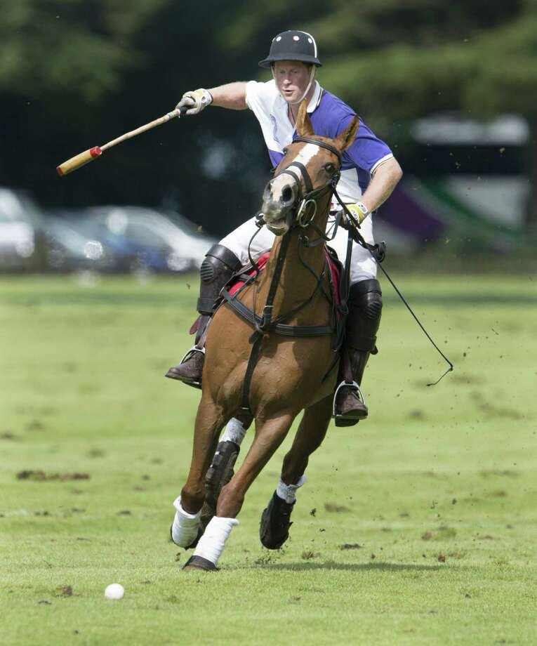 Prince Harry playing in the 2012 Jerudong Trophy Polo Match at Cirencester Park Polo Club in England. BritainâÄôs Prince Harry,the youngest son of Prince Charles and the late Princess Diana is scheduled to compete in a polo match in Greenwich, Conn. in May. The event will benefit Sentebale, a charity he co-founded to help impoverished children in the African nation of Lesotho. Photo: Mark Cuthbert, Photo By Mark Cuthbert/UK Press / Photo by Mark Cuthbert/UK Press via Getty Images
