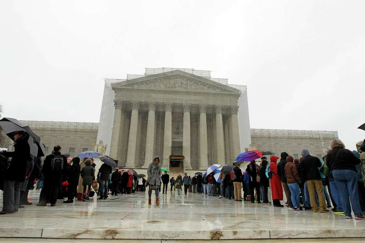 People wait to enter, outside of the U.S. Supreme Court, in Washington, on Monday March, 25, 2013, a day before the case for gay and lesbian couples rights, will be argued before the Supreme Court.