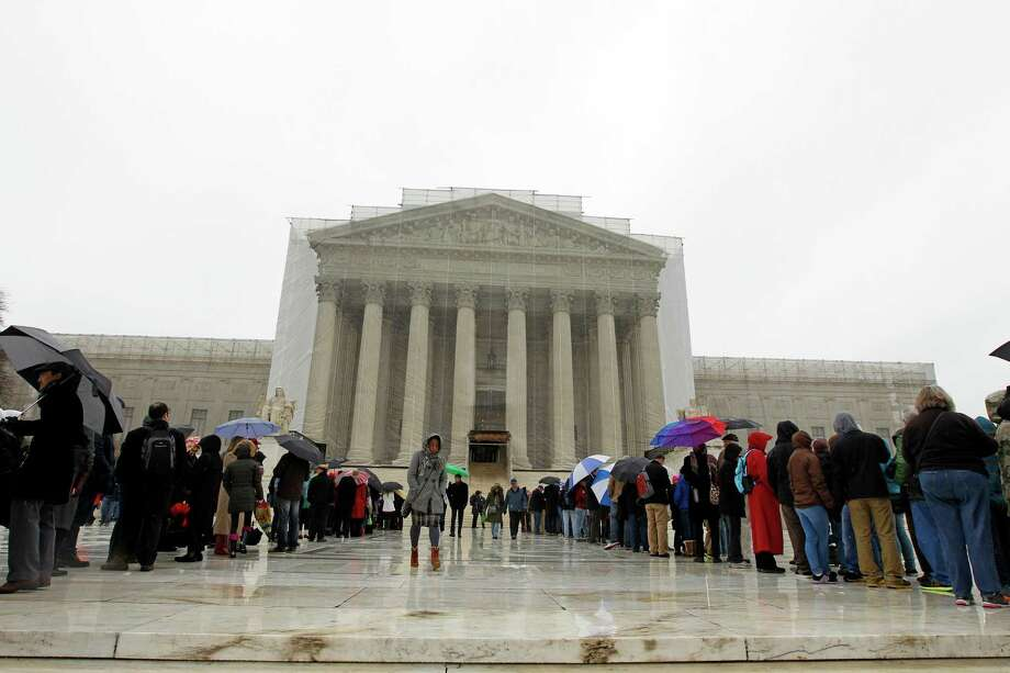 People wait to enter, outside of the U.S. Supreme Court, in Washington, on Monday March, 25, 2013, a day before the case for gay and lesbian couples rights, will be argued before the Supreme Court.  Photo: Jose Luis Magana, Associated Press / FR159526 AP