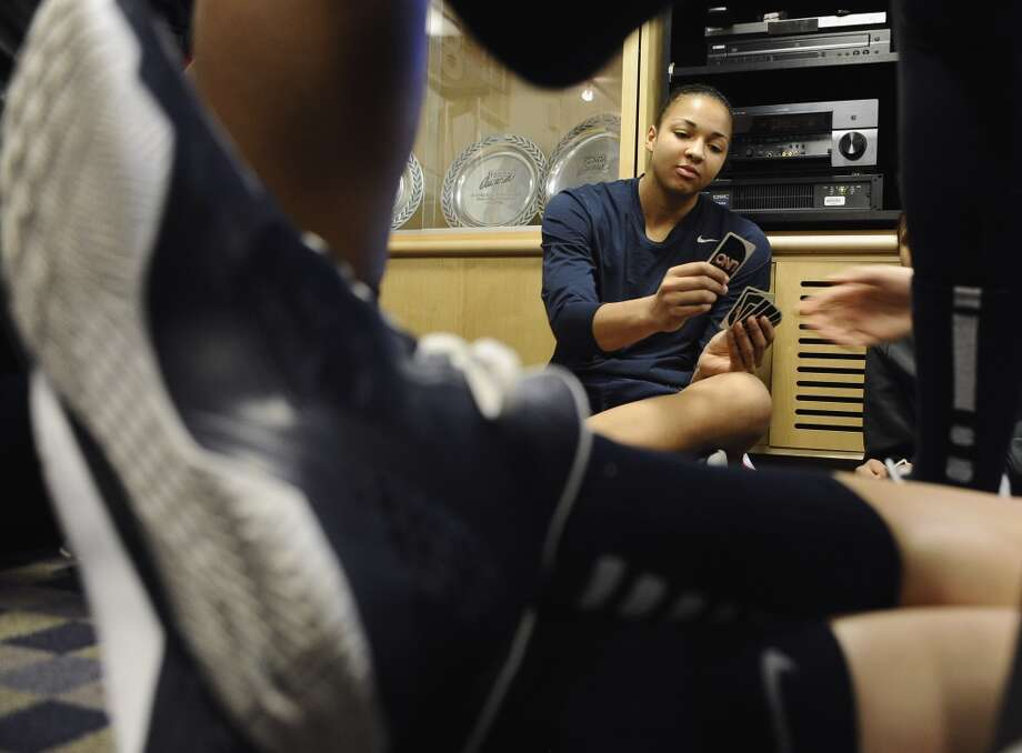 Connecticut's Kiah Stokes plays the card game Uno with her teammates in their locker room before practice for a second-round game in the women's NCAA college basketball tournament in in Storrs, Conn., Sunday March 24, 2013. Connecticut will play Vanderbilt on Monday. (AP Photo/Jessica Hill)