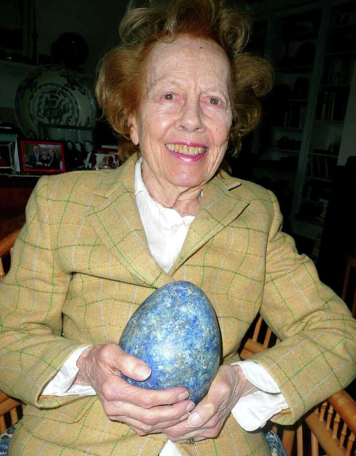 "Artist and Greenwich resident Helen Rowan practices ""the Art of the Painted Finish."" Here, she holds a wooden egg on which she painted a lapis lazuli finish. ""You paint to fool the eye,"" she says. Photo: Anne W. Semmes"