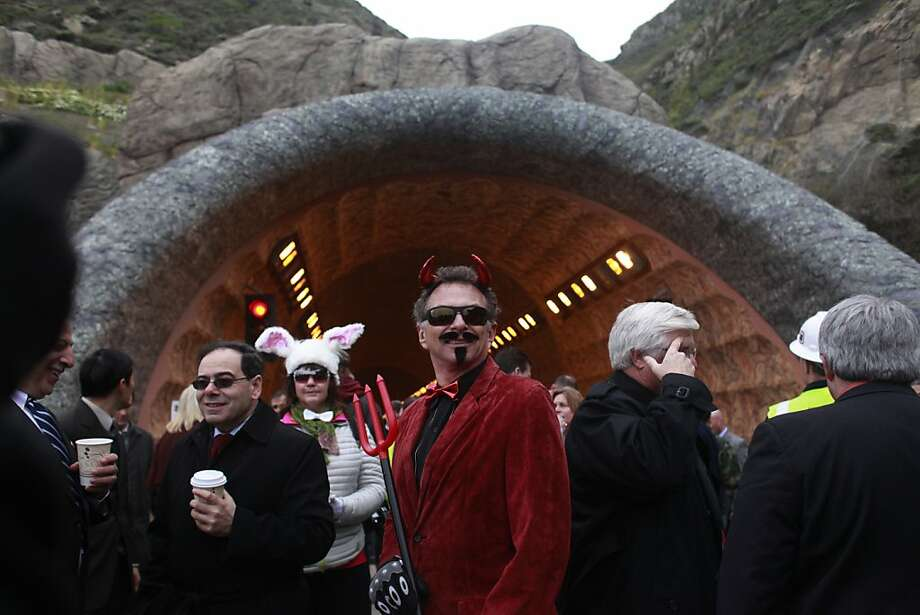 Tony Dominski of Pacifica represents the namesake of Devil's Slide at the invitation-only event to mark the opening of the 4,200-foot tunnel on Highway 1 along the San Mateo County coast. Photo: Mike Kepka, The Chronicle
