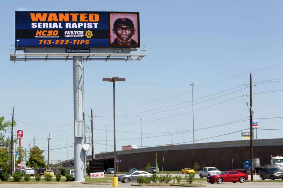 The Sheriff's Office is using a digital billboard along U.S. 59 near FM 1960 to highlight the sketched images of suspects sought in the sexual assaults of seven women in the northern part of Harris County. Photo: Johnny Hanson, Staff / © 2013  Houston Chronicle